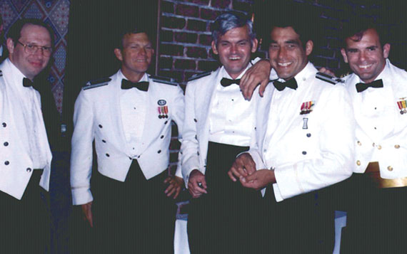 Some of the JPO Heroes at a Dining In. From left, Major Mel Birnbaum (made many important contributions. He was famous for marathon code reviews that could last 18 hours straight. He hated to miss schedules!); Col. Don Henderson (later Maj. Gen.), second Air Force Deputy; Major Ralph Tourino (later Maj. Gen.), Program Control; Lt. Col. Ken Juvette, director of procurement; and Lt. Cdr. Joe Strada, a key leader in the extensive test program. (Credit: Bradford W. Parkinson and Stephen T. Powers)