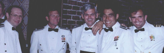 """Some of the JPO Heroes at a """"dining-in,"""" a recognition dinner. From left, Major Mel Birnbaum (made many important contributions. He was famous for marathon code reviews that could last 18 hours straight. He hated to miss schedules!); Col. Don Henderson (later Maj. Gen.) second Air Force deputy; Major Ralph Tourino (later Maj. Gen.), Program Control; Lt. Col. Ken Juvette. director of procurement; and LCdr. Joe Strada, a key leader in the extensive test program. (Credit: Bradford W. Parkinson and Stephen T. Powers)"""