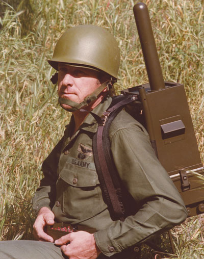 EARLY GPS MANPACK worn by JPO Army deputy Lt. Col. Paul Weber. This photo graced the cover of the first-ever GPS brochure! (Credit: Bradford W. Parkinson and Stephen T. Powers)