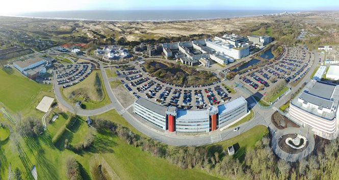 An aerial view of ESTEC. The Erasmus building is at front right. The T building (home to ESA's Galileo team) is in the foreground. (Photo: ESTEC)