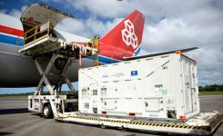 One of the two Galileo satellites 25 and 26 is unloaded from a Boeing 747 cargo jet at Cayenne – Félix Eboué Airport in French Guiana on June 1. The satellites travel inside protective air-conditioned containers. (Photo: ESA)