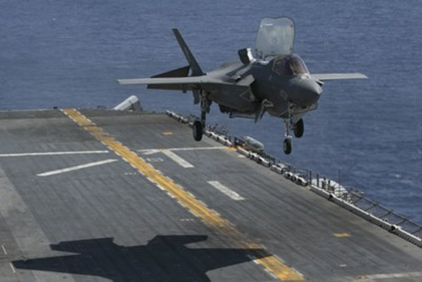 An F-35B Lightning II prepares to land on the flight deck of the USS Wasp while underway in the Philippine Sea, March 23, 2018. (Photo: U.S. Marine Corps/Lance Cpl. Amy Phan)