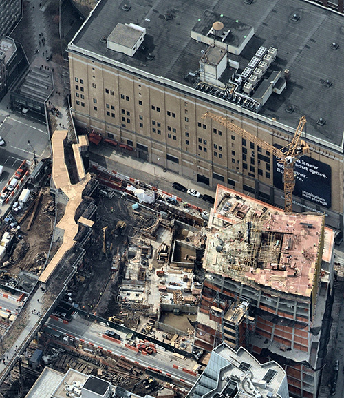 A New York City building site with temporary covered pedestrian walkway. (Photo: Nearmap)