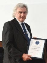 Charles Curry, founder of Chronos Technology, with the RIN award. (Photo: Chronos)