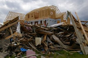 June 28, 2008: A house in Parkersburg, Iowa, is being rebuilt while debris from a deadly EF5 tornado still covers the ground. (Photo: FEMA/Richard O'Reilly)