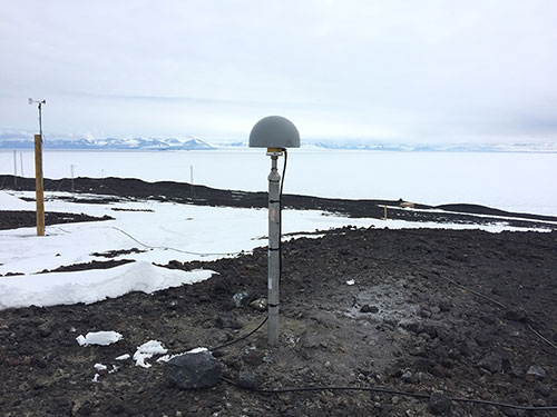 FIGURE 3. The antenna of IGS station ARHT at McMurdo Station, Antarctica. (Photo: IGS)