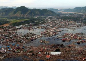 Indian Ocean (Jan. 2, 2005): A village near the coast of Sumatra lays in ruin after the Tsunami that struck South East Asia. (Photo: U.S. Navy/Photographer's Mate 2nd Class Philip A. McDaniel)