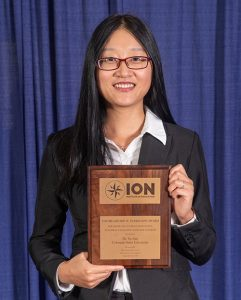 The Institute of Navigation presents Yu Jiao with the Parkinson Award at ION GNSS+ 2018. (Photo: ION)