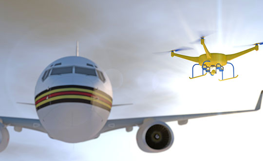 Artist's concept of a drone approaching a commercial airliner. Image: PixOne/Shutterstock.com