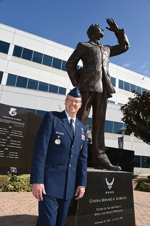 Col. Steve Whitney stands beside a statue of General Schriever at Los Angeles Air Force Base, home of the GPS Directorate. (Photo: U.S. Air Force/Joseph Juarez, Sr.)