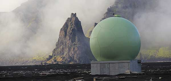 "Protective ""radome"" housing for the Galileo ground station on desolate Jan Mayen Island in the Norwegian Arctic. The site is housing a Galileo Sensor Station plus satellite link to pass data back to the Galileo ground system (Photo: ESA/Fermin Alvarez Lopez)"