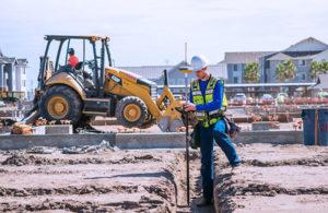 A surveyor checks an urban construction project. (Photo: Topcon)