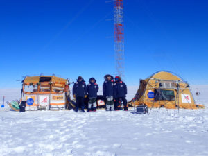 The expedition team with their Inuit WindSled at the high point of Dome Fuji. Note the ESA logo on the left tent of the WindSled. (Photo: Inuit WindSled via ESA)