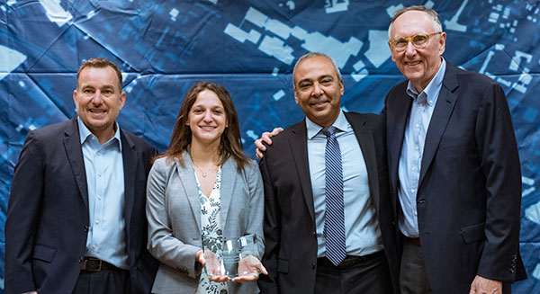From left: Left to Right: Esri Director of Global Business Development Jeff Peters, Eos Sr. Marketing & Content Strategist Sarah Alban, Eos CTO Jean-Yves Lauture, Esri President Jack Dangermond. (Photo: Eos Positioning)
