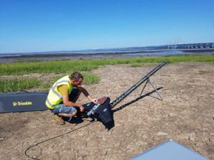 Prepping for flight: Andreas Garbe, AgSurvey, sets up the UX5 HP for a topographic survey at Severn Beach, a village in South Gloucestershire. (Photo: Trimble)