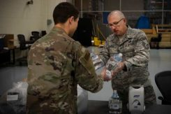 Senior Master Sgt. Michael Welch, 50th Contracting Squadron superintendent, distributes sanitizer to an Airman at the 50th Logistics Readiness Flight warehouse at Schriever Air Force Base, Colorado, April 2, 2020. The 50th CONS secured sanitizing supplies to units across the base to prevent Airmen from contracting COVID-19. (Photo: U.S. Air Force / Airman 1st Class Jonathan Whitely)