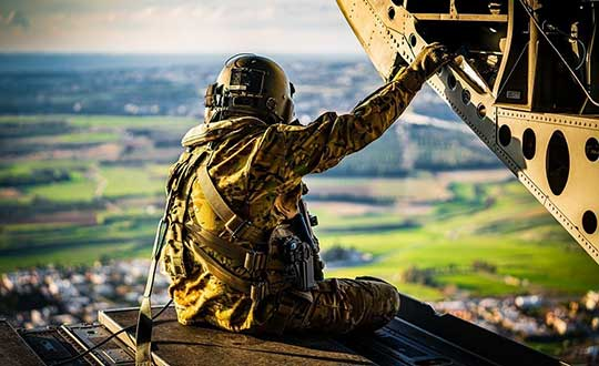 """Staff Sgt. Daniel Pennington, a flight engineer assigned to B Co """"Big Windy,"""" 1-214th General Support Aviation Battalion, takes in his 'office' view from the ramp of his CH-47 Chinook while flying over the island of Cyprus on Jan. 14, 2020.(Photo: U.S. Army/Maj. Robert Fellingham)"""