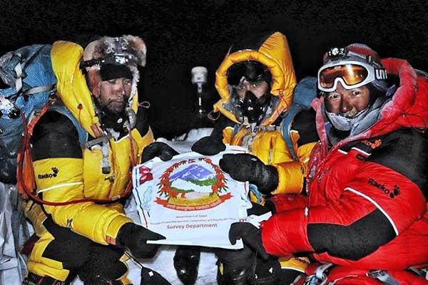On the summit: Chief Officer Khim Lal Gautam, Survey Officer Rabin Karki, Sherpa Tshiring Jangbu, and the Trimble R10. (Photo: Trimble)