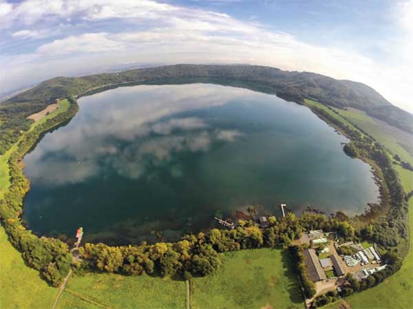 An aerial view of Laacher See, a volcanic caldera lake with a diameter of 2 km in Rhineland-Palatinate, Germany. Created by volcanic activity, maars like this are also found in other parts of Europe and on other continents, but Eifel-Maars are the classic example worldwide. (Photo: bbsferrari/iStock / Getty Images Plus/Getty Images)