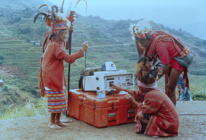 "A Malaysian tribe and the Trimble 4000SLD, the first kinematic ""backpack"" GPS receiver. Weighing 44 lbs. without batteries, the receiver was introduced in 1988. (Photo: Trimble)"