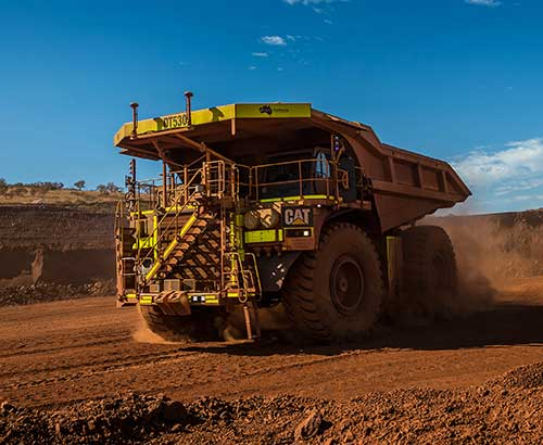 Auto Mining: A driverless Cat 793F CMD truck leaves an iron ore pit. (Photo: Caterpillar)