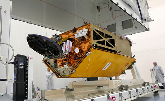 The Sentinel-6 Michael Freilich spacecraft undergoes tests at its manufacturer Airbus in Friedrichshafen, Germany, in 2019. The white GNSS-RO instrument can be seen attached to the upper left portion of the front of the spacecraft. (Photo: Airbus)