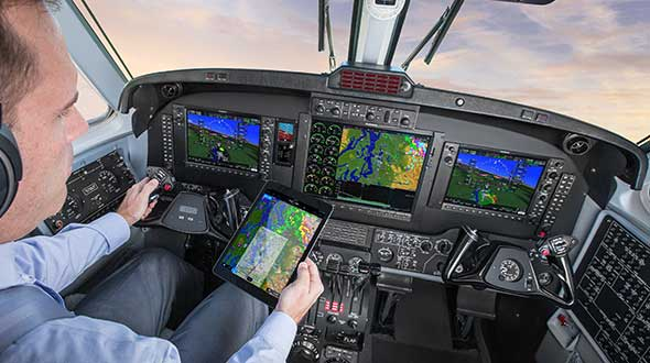 In a simulated G1000 NXi integrated flight deck for a King Air 350, a pilot refers to the Garmin Pilot app, used as a supplement during flight. (Photo: Garmin)