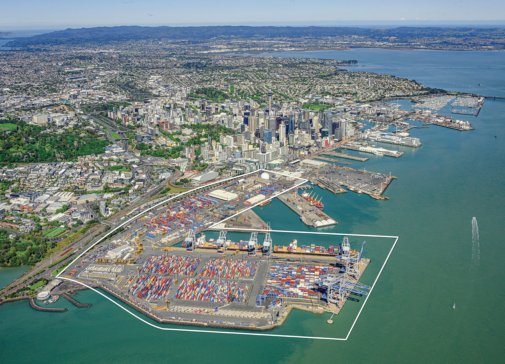 Figure 1. The Ports of Auckland covers 140 acres at the doorstep of Auckland's central business district. The outline shows the approximate coverage of the LocataNet local positioning system (landside only). (Photo: Ross Clark/Ports of Auckland)