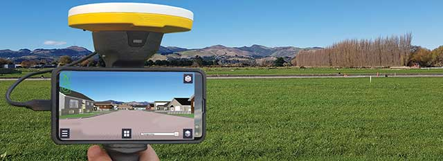 Trimble SiteVision uses Catalyst and augmented reality to preview a new housing development in an open field. (Photo: Trimble)