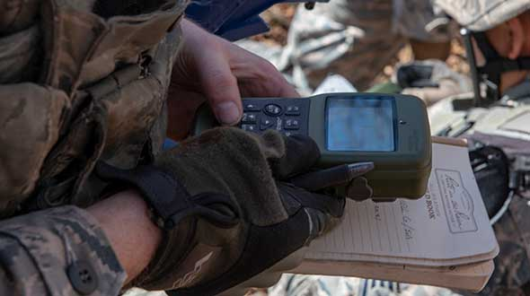 An Airman with the 374th Security Forces Squadron uses a Defense Advanced GPS Receiver (DAGR) to track the team's current during a 2018 field training exercise at Camp Fuji, Japan. (Photo: Senior Airman Matthew Gilmore/U.S. Air Force)