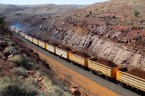 Hitachi Rail and Rio Tinto collaborated to build the world's first driverless heavy freight train – an automated heavy haul freight transportation system delivering freight from mines to ports in Australia across thousands of kilometres every day. (Photo: Hitachi Rail)