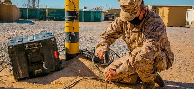 A U.S. Marine Corps radio operator grounds an during long-range HF radio training in Kuwait Oct. 7, 2020. (Photo: U.S. Marine Corps/Capt. Joshua Hays)