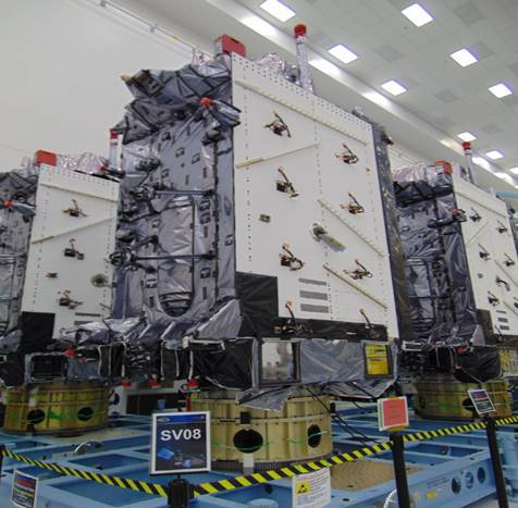 """The U.S. Space Force's Space Systems Command recently declared GPS III SV06, SV07 and SV08 satellites """"Available for Launch."""" Here, the space vehicles await official call up for launch in Lockheed Martin's GPS III Processing Facility in Waterton, Colorado. (Photo: Lockheed Martin)"""