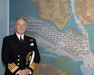 Admiral Sir Alan West, then First Sea Lord, is pictured with the official chart of anchorages for the International Fleet Review. (Photo: DP Kilfeather's book Trafalgar 200 Through the Lens Queen Elizabeth II 80th Birthday Edition, CC BY-SA 2.5)