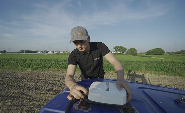 Installation of the NX510 Pro auto-steering system to a tractor. (Photo: CHCNAV)