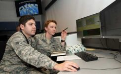 Second Lt. Kelley McCaa, 2nd Space Operations Squadron satellite vehicle operator, and Airman 1st Class John Garcia, 2nd SOPS satellite systems operator, set satellite vehicle number-74, the first iteration of GPS Block III vehicles, as healthy and active to users Jan. 13, 2020, Schriever Air Force Base, Colorado,. Setting the vehicle healthy and active makes the satellite available for use by military and civilian GPS users around the world for agriculture, banking and navigation. (Photo: U.S. Air Force/Staff Sgt. Matthew Coleman-Foster)