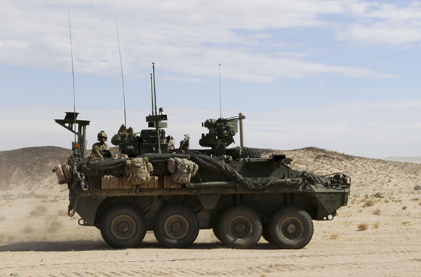 Soldiers from 2-2 Stryker Brigade Combat Team move out in their Stryker during their training rotation at the National Training Center on Fort Irwin, Calif., Sept. 2, 2019. (Photo: Sgt. Ryan Barwick/U.S. Army)