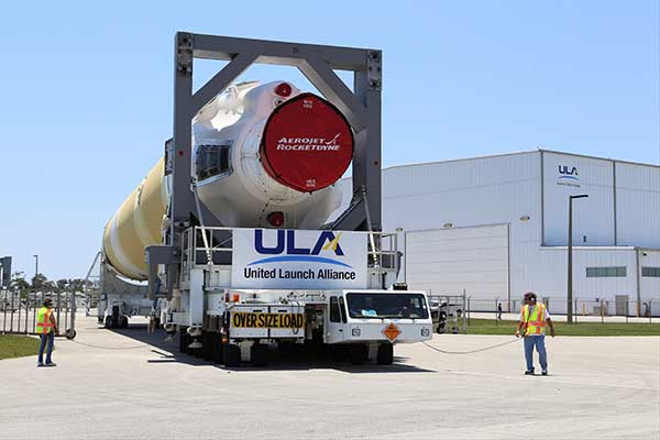 The Delta IV rocket leaves the the Horizontal Integration Facility (HIF) aboard a 36-wheel, diesel-powered transporter on May 28 and traveled to Space Launch Complex-37. The trip took 40 minutes. (Photo: ULA)