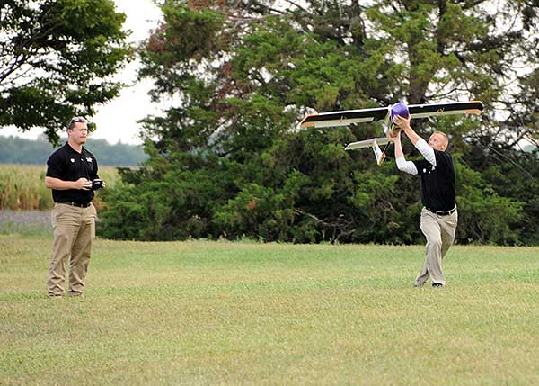 Launching a UAV for a BVLOS flight are (at left) Travis Balthazor, UAS flight operations manager, and Mike Kuni, UAS flight instructor/pilot, both of Kansas State University Polytechnic Campus. (Photo: KDOT, Division of Aviation)