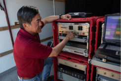 A Raytheon technician operates the rapidly installed JPALS equipment during a demonstration at the Naval Air Station. (Photo: Raytheon)