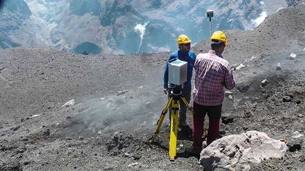Dust, noxious gas and loose rock near the summit makes volcanic surveying especially challenging. (Photo: Trimble)
