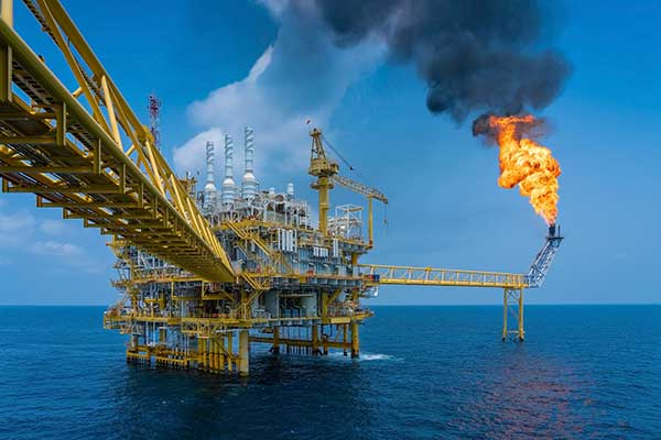 An offshore oil and gas construction platform vents gases to relieve pressure. Flame stacks such as these require regular inspection. (Photo: Oil and Gas Photographer/Shutterstock.com )