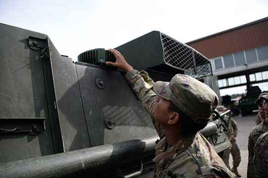 A soldier checks part of a Mounted Assured Precision Navigation & Timing System -- known as MAPS. Sixty-two of the first iteration of mounted anti-jam GPS devices were equipped into light armored vehicles in Germany over the past month, with thousands more scheduled to be installed into U.S. European Command vehicles by 2028. (Photo: John Higgins)